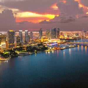 Miami skyline at sunset with SAFe 5 RTE badge