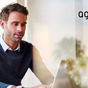 Professional man in front of laptop with AgileFire logo